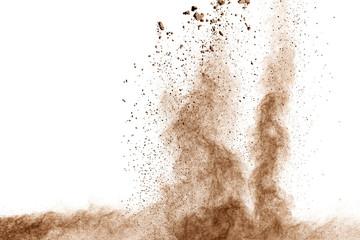 Fototapeta Brown dust explosion cloud.Brown particles splatter on white background.
