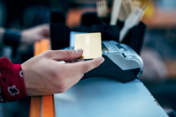 Male using payment terminal at counter stock photo