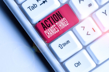 Conceptual hand writing showing Action Changes Things. Concept meaning start doing something against problem resolve or achieve it White pc keyboard with note paper above the white background