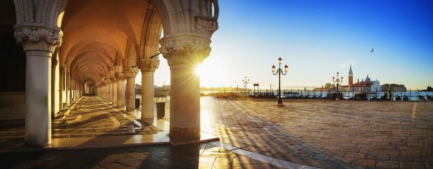 San Marco with the curch San Giorgio di Maggiore in the background in Venice, Italy at a dramatic sunrise