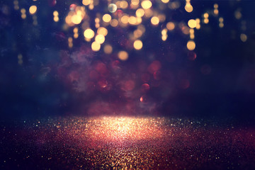 background of abstract glitter lights. gold and black. de focused