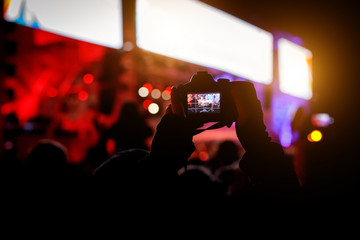 Silhouette of a smartphone in the hands. Stage shooting.