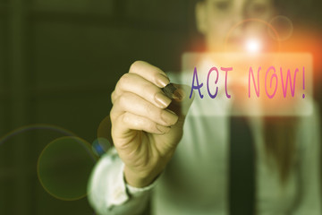 Writing note showing Act Now. Business concept for do not hesitate and start working or doing stuff right away Blurred woman in the background pointing with finger in empty space