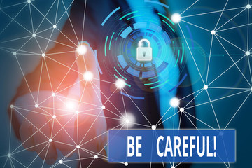 Writing note showing Be Careful. Business concept for making sure of avoiding potential danger mishap or harm Picture photo network scheme with modern smart device
