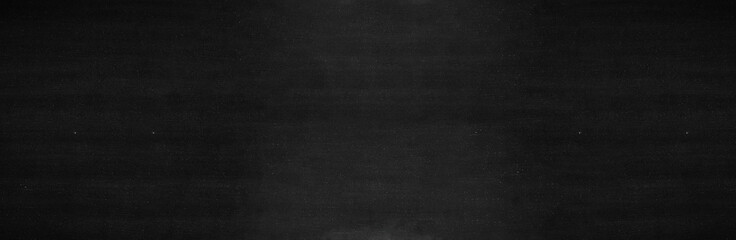 Blank wide screen Real chalkboard background texture in college concept for back to school panoramic wallpaper for black friday white chalk text draw graphic. Empty surreal room wall blackboard pale.