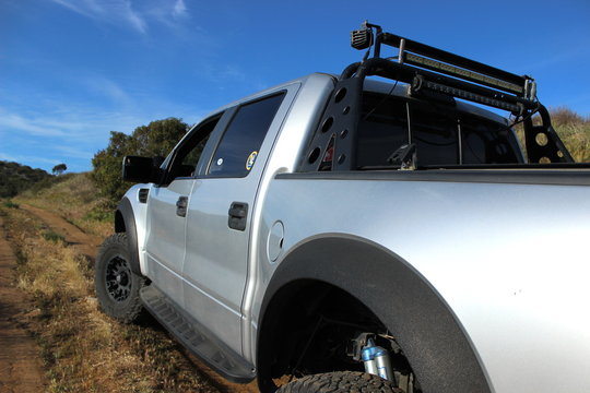 Customized 2011 Ford F-150 Raptor SVT pick-up truck on a dirt road (exterior style is same for all 2010-2014 models). Photo taken in Valley Center, CA / USA on April 25, 2018.