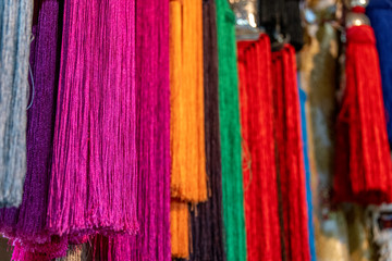 Colorful textiles hanging before being used for textiles