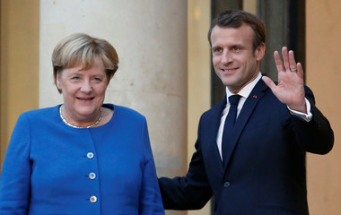 French President Emmanuel Macron meets German Chancellor Angela Merkel in Paris