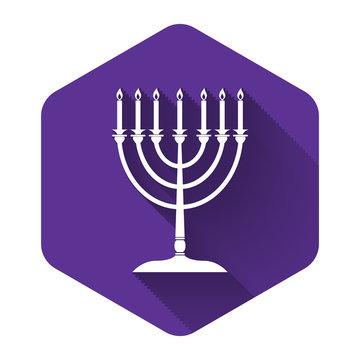 White Hanukkah menorah icon isolated with long shadow. Religion icon. Hanukkah traditional symbol. Holiday religion, jewish festival of Lights. Purple hexagon button. Vector Illustration