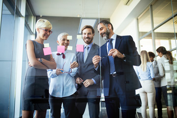 Wall Mural - Successful team leader and business owner leading informal in-house business meeting