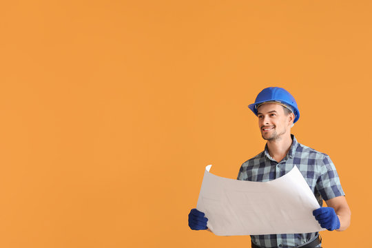 Portrait of male architect on color background