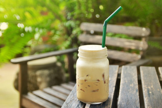iced cappuccino coffee on wooden table