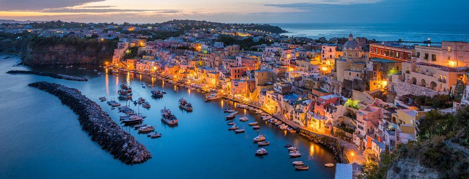 Panoramic sight of the beautiful island of Procida in the evening, near Napoli, Campania region, Italy.