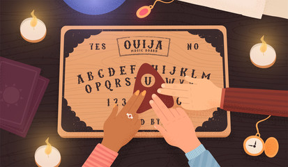 Ouija board. Communicating with ghosts. People conducting a seance using a spiritual board. Top view