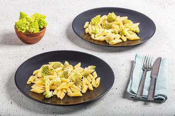 Pasta with Romanesco Cauliflower on concrete table
