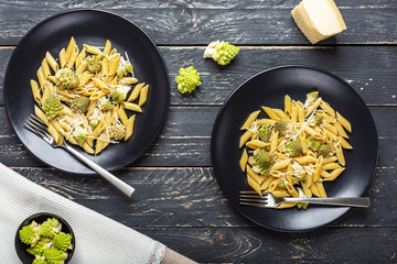 Pasta with Romanesco Cauliflower on black wooden table