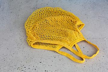 Eco cotton string bag on a concrete background