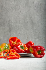 Sweet fresh red pepper with gray background