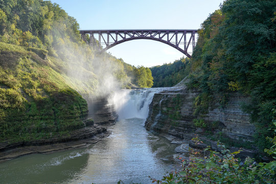 Upper falls at the Letchworth State Park located in New York. Arched bridge, railroad tracks above the falls.