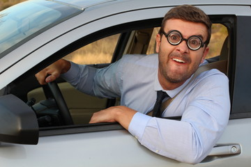 Obnoxious driver with very thick eyeglasses