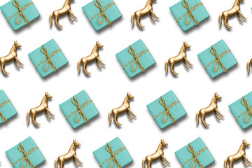 gift box and gold horse pattern composition. christmas or holiday background