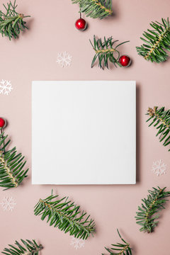 Blank card with fir tree branches red berries and star on pink background