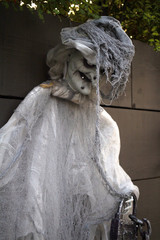 scary old witch hag halloween decoration for trick or treaters