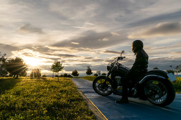 biker on the road on sunset