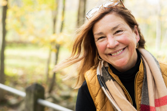candid portrait of happy woman in autumn