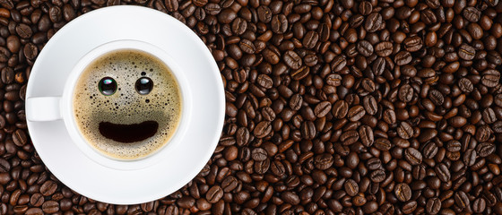Poster Café en grains panoramic coffee background of a cup of black coffee with smiling face coffee bubble on background of roasted arabica coffee beans