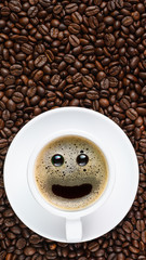 panoramic coffee background of a cup of black coffee with smiling face coffee bubble on background of roasted arabica coffee beans