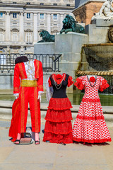 Traditional flamenco and matador costumes photo props at the fountain in Plaza de Oriente Royal Palace in Madrid, Spain