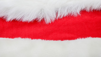 red and white fabric christmas background, red cloth and soft white fur
