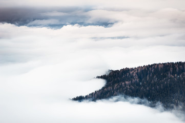 Foggy morning in the winter mountains. Dolomite Alps, Italy