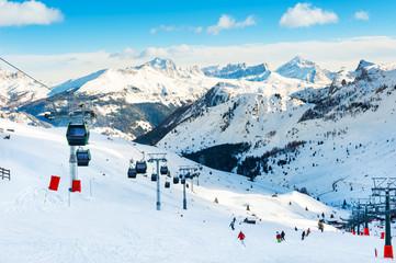 Ski slopes on ski resort in winter Dolomite Alps. Val Di Fassa, Italy. Winter holidays, travel destination
