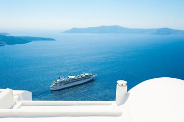White architecture and blue sea on Santorini island, Greece. Summer holidays, travel destinations concept