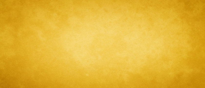 Gold or yellow vintage background texture with old grunge borders and soft blended paint center, studio backdrop in elegant luxury colors
