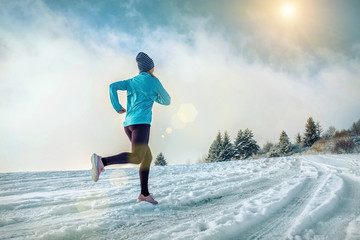 Poster Glisse hiver Running woman. Runner on the snow in winter sunny day. Female fi