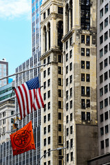 Hermes store banner and american flag against skyscrapers in New York
