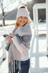 young blonde woman in a winter park