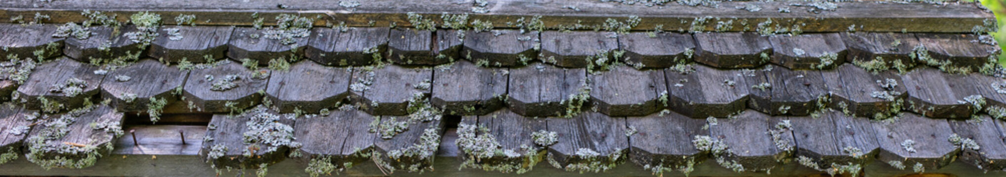 Old wooden roof texture. Detail of shingled roof of old wood-frame building