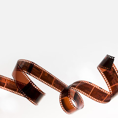 Curled filmstrip isolated on white background