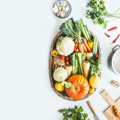 Food background with fresh organic vegetables for tasty autumn seasonal cooking from local market on white kitchen table, top view. Copy space