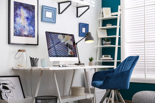 Home workplace with modern computer and desk in room