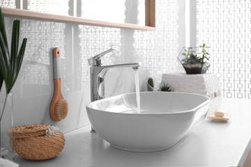 Stylish white sink in modern bathroom interior
