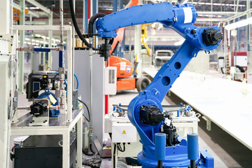 The robot glass sealing 's waiting for new product in automotive smart factory.