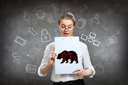 Business woman holds folder with silhouette bear financial icon.