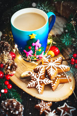 A Cup of hot cocoa and Christmas cookies on the background of Christmas garlands. Merry Christmas and happy New year. Selective focus.