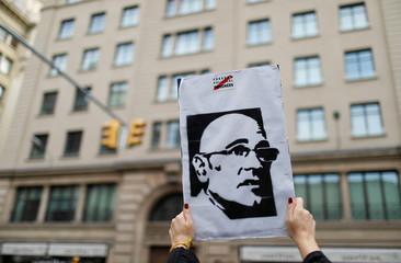A woman holds a picture of Catalan politician Raul Romeva during a protest after a verdict in a trial over a banned independence referendum in Barcelona