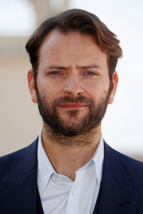 """Actor Alessandro Borghi poses during a photocall for the television series """"Devils"""" during the annual MIPCOM television programme market in Cannes"""
